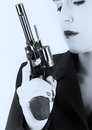 Dangerous woman in black with big handgun and stylish hat artistic conversion Stock Image