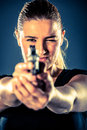 Dangerous woman terrorist dressed in black with a gun in her han hands Royalty Free Stock Images