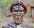 DANI VILLAGE, WAMENA, IRIAN JAYA, NEW GUINEA, INDONESIA, 15 MAY 2016: Close up Portrait of Yali Mabel, the chief of Dani tribe. Du Royalty Free Stock Photo