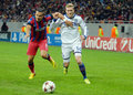 Daniel georgievski of steaua and andre schurrle of chelsea s s pictured in acion during the uefa champions league group e game Royalty Free Stock Images