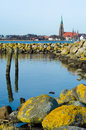 Danish church in schleswig germany anchored by moss covered rocks Stock Photography