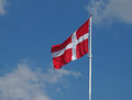 Danish flag flapping on clear blue sky Stock Photo