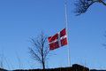 Danish flag swaying on half during burial Stock Images