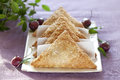 Danish pastry cherry turnovers on plate on table Stock Photos