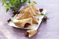 Danish pastry cherry turnovers on table Royalty Free Stock Photos