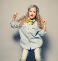 Dansing girl child motions fashion studio shot Royalty Free Stock Photo