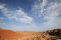 Danxia landform with cloud Royalty Free Stock Photography
