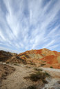Danxia landform with clouds located in zhanye gansu china Royalty Free Stock Image