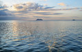 Daphne minor and daphne major at sunset from a boat cruise with islands background galapagos island ecuador Stock Photo
