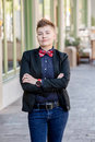 Dapper Gender Fluid Young Woman with Arms Crossed Royalty Free Stock Photo