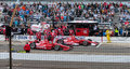 Dario franchitti beating scott dixon out of the pit at indy Stock Photo