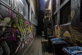 Dark alley with graffiti Royalty Free Stock Photo