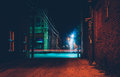 Dark alley and light trails in Hanover, Pennsylvania at night. Royalty Free Stock Photo