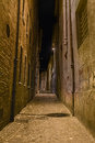 Dark alley in the old town Royalty Free Stock Photo