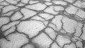Dark asphalt road with cracks outdoors photography of damaged driveway Royalty Free Stock Images