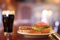Dark beer and burger Stock Image