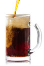 Dark beer pouring into glass isolated on white background Royalty Free Stock Image