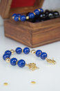 Dark blue Beaded Bracelet with gold clasp Royalty Free Stock Photo