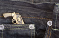 Dark blue denim jeans with a gun Royalty Free Stock Photo