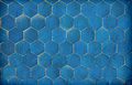 Dark blue hexagonal blue tiles simple and plain creating a pattern Stock Photography