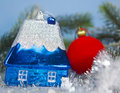 Dark blue new year s toy small house idea of dream of own house in new year Royalty Free Stock Image