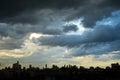 Dark blue storm clouds over city in rainy season Royalty Free Stock Photo
