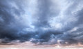 Dark blue stormy cloudy sky natural photo background Royalty Free Stock Photo