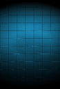 Dark blue tiled wall with spotlight a neat as a background Royalty Free Stock Images