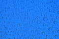 Dark blue water drops background close up Stock Photos