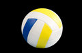 Dark blue yellow volley ball ball on a black background Royalty Free Stock Image
