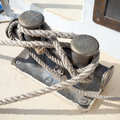 Dark bollard with rope on yacht deck knot Stock Image