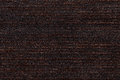 Dark brown background from soft textile material. Fabric with natural texture. Royalty Free Stock Photo