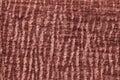 Dark green fluffy background of soft, fleecy cloth. Texture of plush furry textile, closeup.