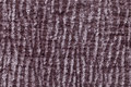Dark brown fluffy background of soft, fleecy cloth. Texture of textile closeup Royalty Free Stock Photo