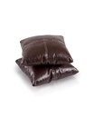 Dark brown leather cushions on white background Royalty Free Stock Images