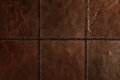 Dark brown leather patchwork Stock Images