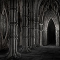 Dark cathedral columns and doors in a gothic Royalty Free Stock Photography