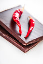 Dark chocolate chunks with two red chillies Royalty Free Stock Photo