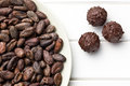 Dark chocolate truffles and cocoa beans top view of Royalty Free Stock Image