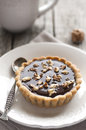 Dark chocolate walnuts tart old syle table Stock Images