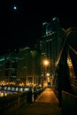 Dark city steel bridge and river promenade at night in Chicago. Royalty Free Stock Photo