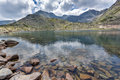 Dark Clouds over Musala peak and reflection in Musalenski lakes,  Rila mountain Royalty Free Stock Photo