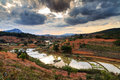 Dark clouds rice fields over in the countryside of madagascar Stock Photos