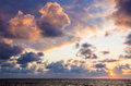 Dark clouds at sunset behind over sea Royalty Free Stock Photography
