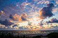Dark clouds at sunset behind over sea Royalty Free Stock Image