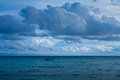 Dark cloudy stormy sky with clouds and waves in the sea Royalty Free Stock Image