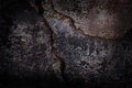 Dark concrete texture of wall with cracks Stock Image