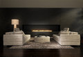 Dark contemporary interior, a living room with a flat gas fireplace Royalty Free Stock Photo
