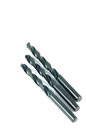 Dark drill bits on a white background Royalty Free Stock Photo