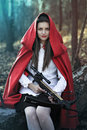 Dark fantasy little red riding hood with no fear of the wolf Royalty Free Stock Photography